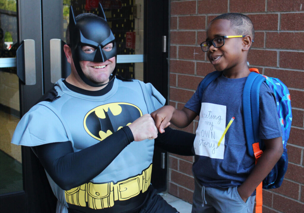 from left is Batman with Avanalist Jackson IV, whose haircut features a superhero star.