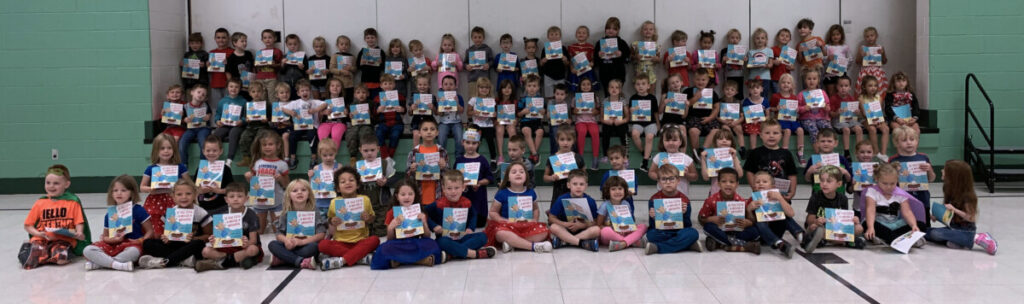 McNinch Primary kindergarten students pose in the school's gym with their brand new book.