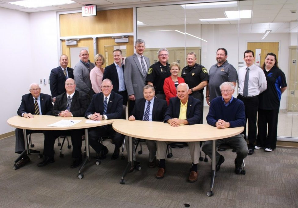 On Friday Marshall County Commissioners as well as the mayors from the cities of Marshall County, members of the West Virginia Legislature along with the Sheriff gathered to sign a proclamation declaring November 12-16, 2018 as American Education Week in Marshall County.